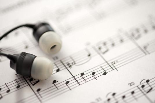 sheet music and earbud headphones